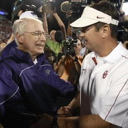 Kansas State coach Bill Snyder, left, and Oklahoma coach Bob Stoops talk following an NCAA college football game in Norman, Okla., Saturday, Sept. 22, 2012. Kansas State won 24-19.
