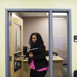 Raisa Carrasco-Velez, director of Multicultural Affairs & Community Development at St. John's Preparatory, leaves her office at the school in Danvers, Massachusetts on March 13, 2017.