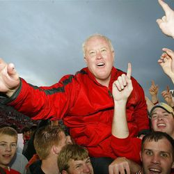 Utah head football coach Ron McBride is carried off the field after beating BYU 13-6 Saturday, Nov. 23, 2002 at Rice-Eccles Stadium in Salt Lake City.