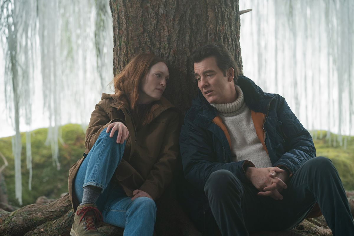 Julianne Moore and Clive Owen sit upside down under a magical silver willow in Lisey's story
