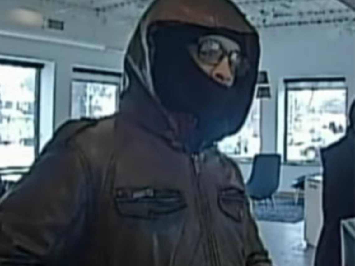 A surveillance photo of the armed suspect who robbed a bank branch Saturday morning in Oak Park. | FBI