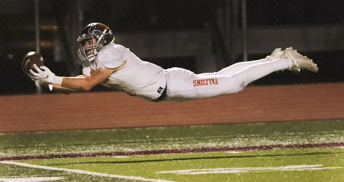 Skyridge's James Palmer (6) stretches out for a catch that later led to a touchdown against Lone Peak in a 6A semifinal football game in Eagle Mountain on Thursday, Nov. 12, 2020.