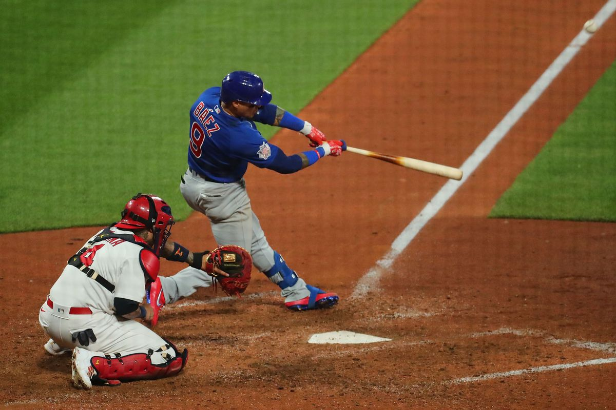 Javy Baez hits a go-ahead two-run homer in the 10th inning against the Cardinals on Sunday night in St. Louis.