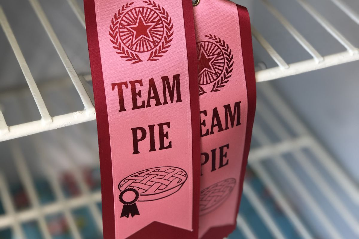 """Two ribbons inside a vintage icebox say """"Team Pie"""""""
