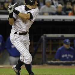 New York Yankees' Ichiro Suzuki watches his eighth-inning RBI-single against the Toronto Blue Jays in  Game 2 of a baseball doubleheader at Yankee Stadium in New York, Wednesday, Sept. 19, 2012.  Suzuki had the winning hit and four stolen bases in the Yankees' victory.