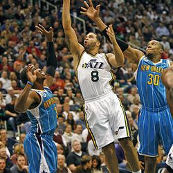 Utah's Deron Williams drives on the Hornet's Chris Paul (left) and David West as the Utah Jazz and the new Orleans Hornets play NBA basketball  Wednesday, Nov. 24, 2010, in Salt Lake City, Utah.