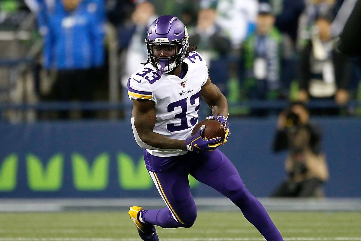 Running back Dalvin Cook of the Minnesota Vikings carries the ball against the defense oat CenturyLink Field on December 02, 2019 in Seattle, Washington.