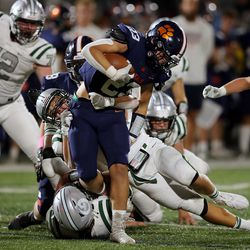 Brighton's Mitch Dolato is tackled by Olympus' Isaac Hodgson and Simon Mayfield as they play a high school football game at Brighton in Cottonwood Heights on Friday, Sept. 10, 2021. Olympus won 35-28.