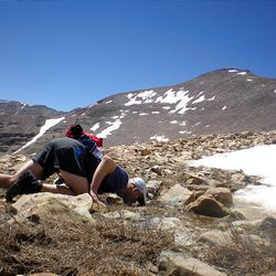 Ultramarathon runner Craig A. Lloyd, 37, of Holladay, drinks from some snow runoff below Kings Peak.