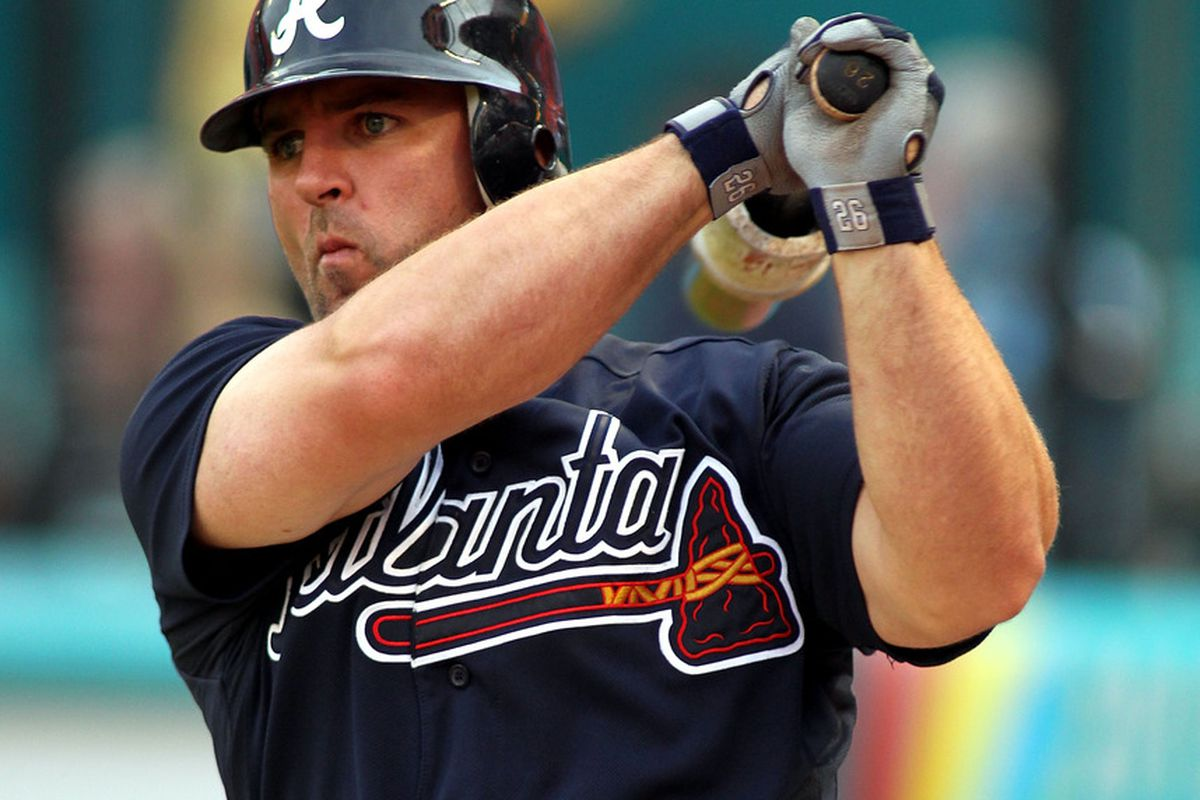 MIAMI GARDENS, FL - AUGUST 08:  Dan Uggla #26 of the Atlanta Braves prepares to bat against the Florida Marlins at Sun Life Stadium on August 8, 2011 in Miami Gardens, Florida.  (Photo by Marc Serota/Getty Images)