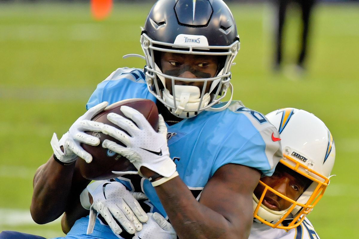 Tennessee Titans wide receiver Corey Davis catches a pass against Los Angeles Chargers cornerback Casey Hayward during the second half at Nissan Stadium.