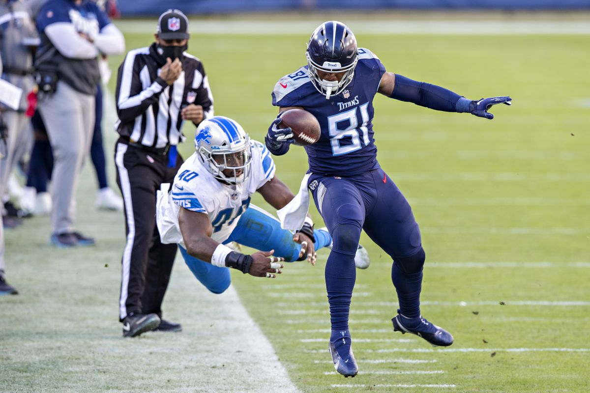 Tight end Jonnu Smith #81 of the Tennessee Titans runs the ball and is pushed out of bounds by linebacker Jarrad Davis #40 of the Detroit Lions at Nissan Stadium on December 20, 2020 in Nashville, Tennessee. The Titans defeated the Lions 46-25.