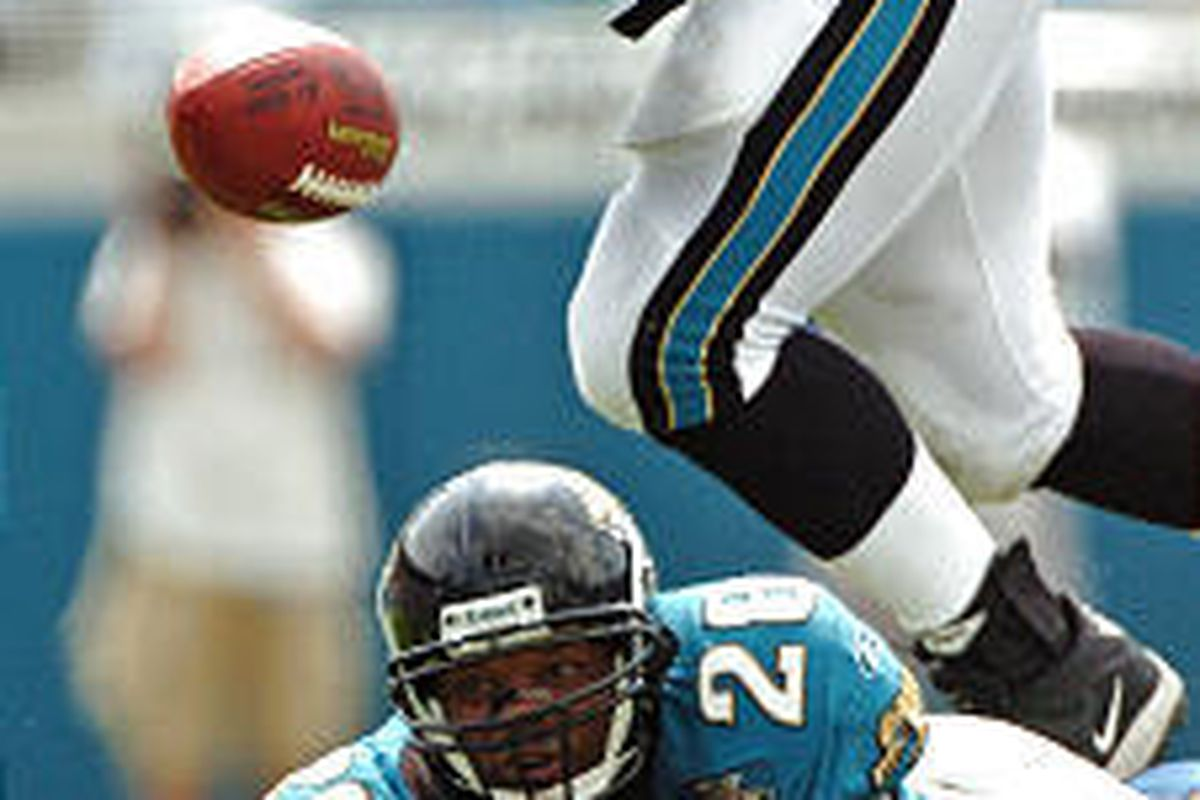 The Jacksonville Jaguar's Fred Taylor watches his fumble against the Indianapolis Colts on Sunday.
