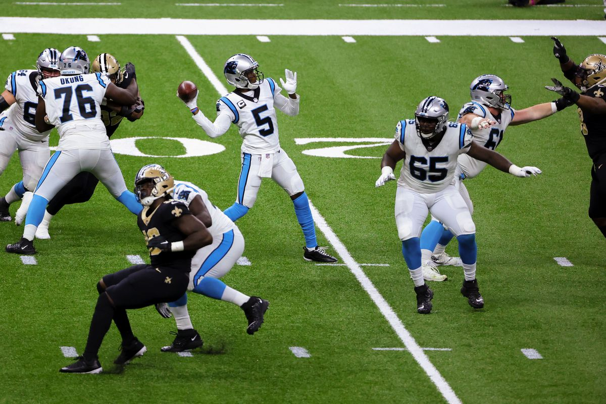 Carolina Panthers quarterback Teddy Bridgewater (5) throws a touchdown against the New Orleans Saints during the second quarter at the Mercedes-Benz Superdome.