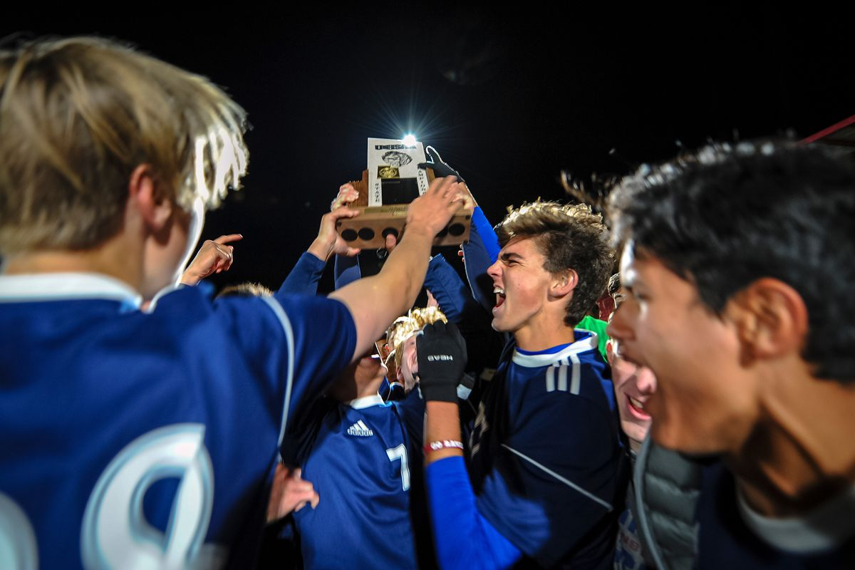 Waterford lifts the State 2A soccer champion trophy after defeating Rowland Hall at Zions Bank Stadium at the RSL Academy in Herriman on Saturday, May 12, 2018.