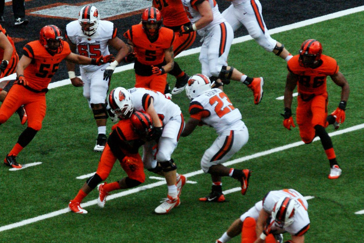 """The Oregon St. football team will square off in """"Orange and White Action"""" this afternoon."""