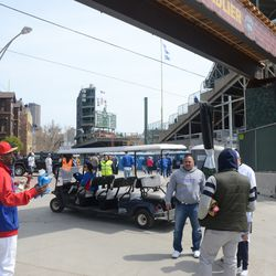 """1:06 p.m. One of the Cubs' """"limo"""" service carts, on Waveland -"""