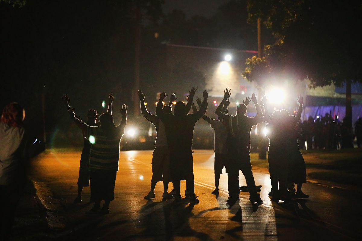 Ferguson residents gather near a police line on August 11.