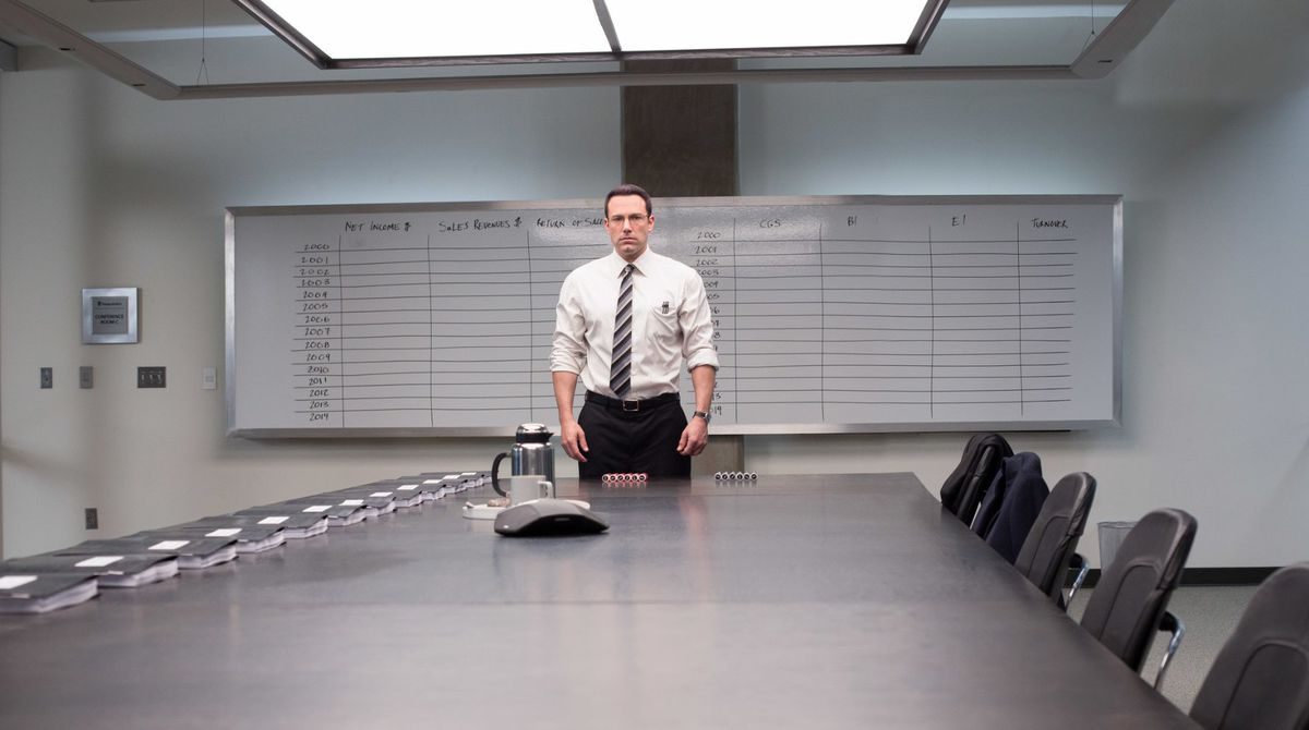Ben Affleck stands in a boardroom in The Accountant