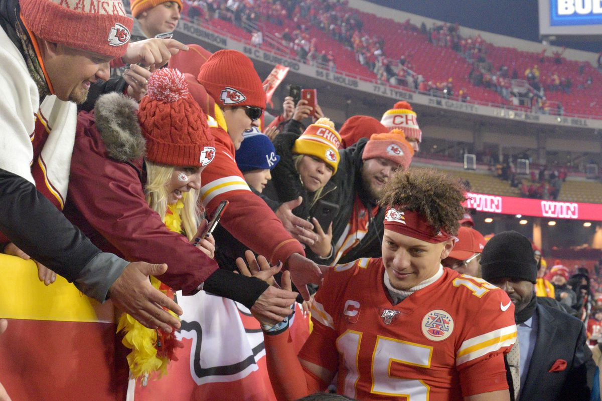 Kansas City Chiefs quarterback Patrick Mahomes greets fans while leaving the field after the AFC Divisional Round playoff football game against the Houston Texans at Arrowhead Stadium.