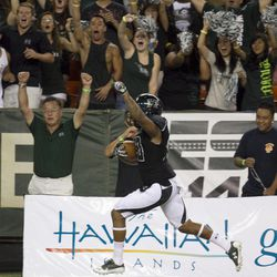 After Hawaii special teams blocked a punt, Hawaii defensive back Ne'Quan Phillips returns the ball for a touchdown during the second quarter of the NCAA game between the Lamar and Hawaii, Sept. 15, 2012 in Honolulu.