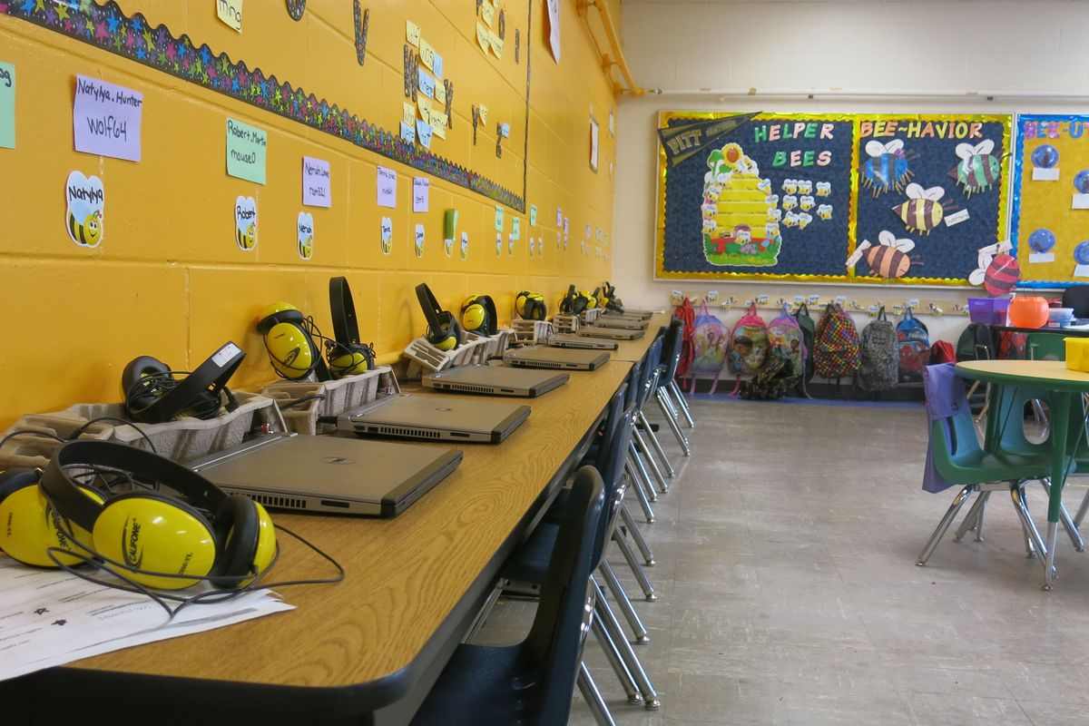 A row of computers line a classroom at Aspire Hanley Elementary School in Memphis.