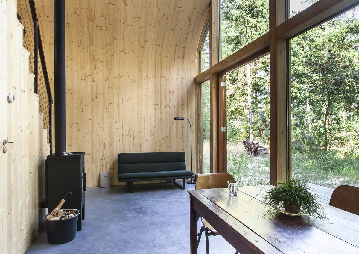 Living room with bent wood walls.