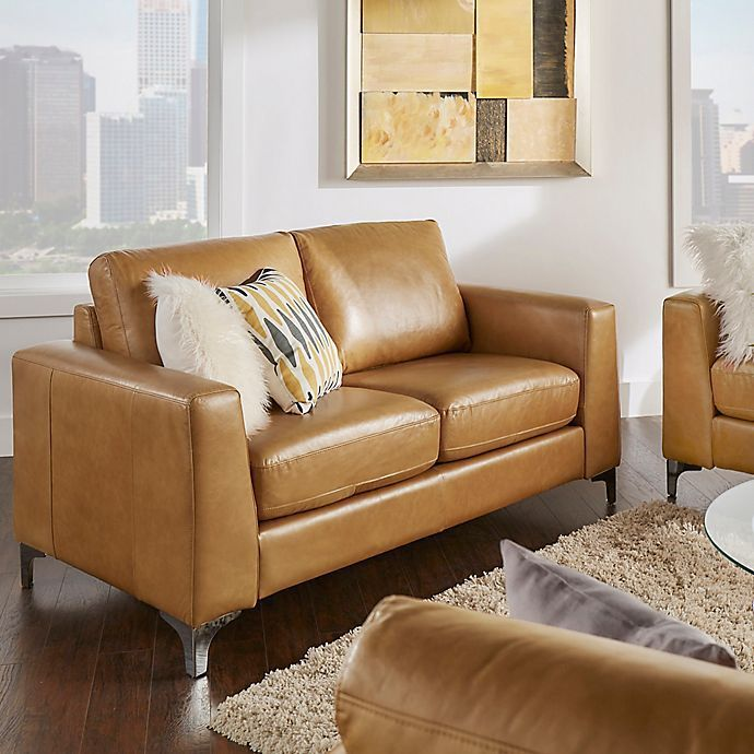 Caramel-colored leather loveseat.