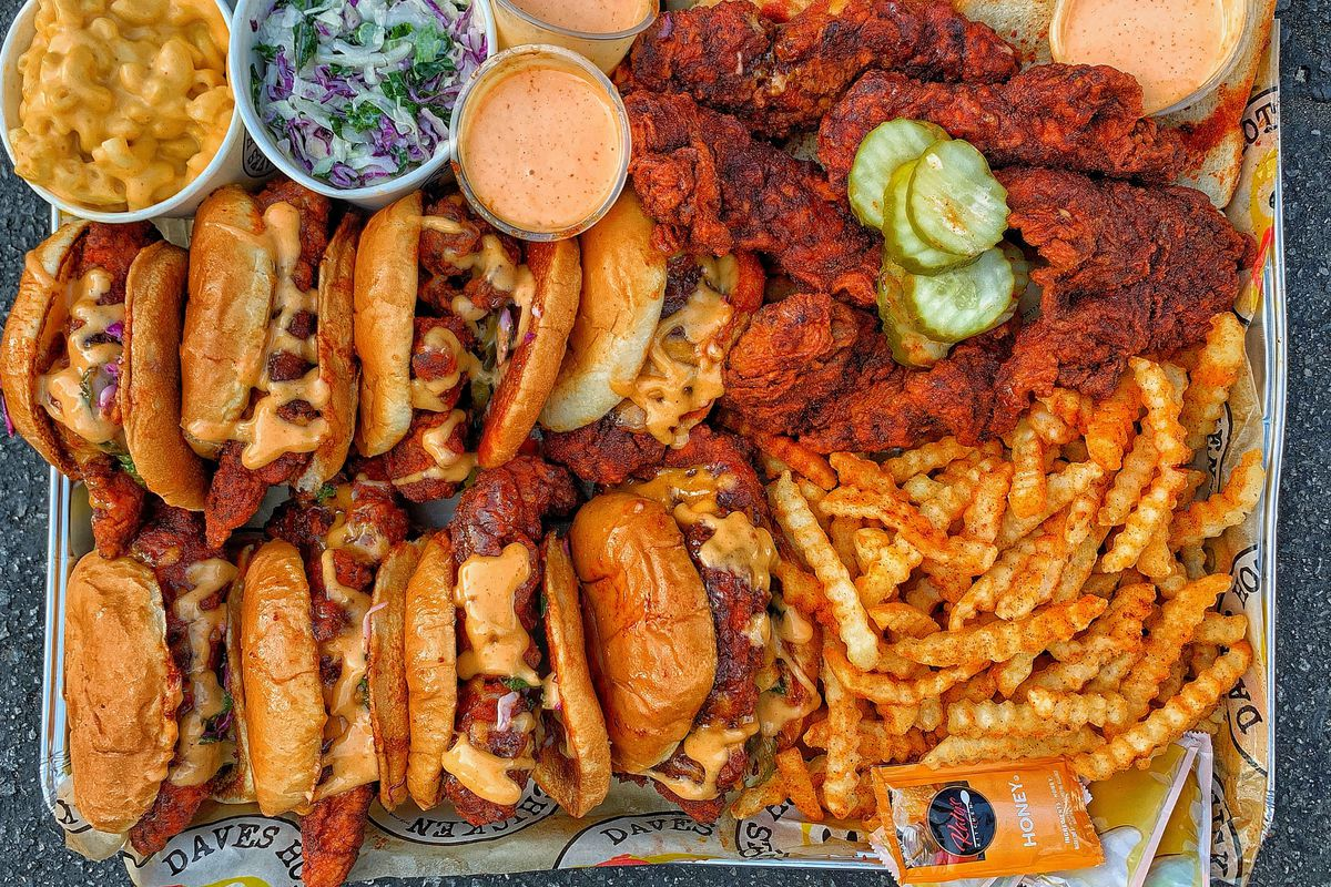 A tray of fries, fried chicken, and more.