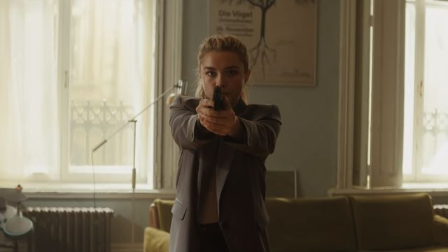 Florence Pugh holds a gun as Yelena Belova in Black Widow