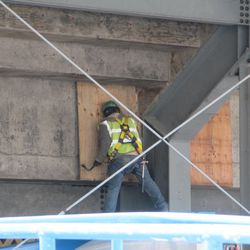 11:32 a.m. Worker about to remove a board from under the left-field bleachers -