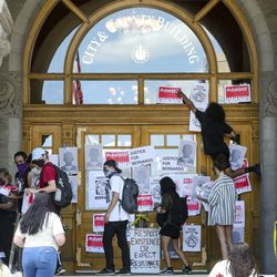 Demonstrators put signs on the Salt Lake City-County Building on Thursday, July 2, 2020, during the latest protest decrying the death of Bernardo Palacios-Carbajal, who was shot and killed by police in May. The protest was cut short after the police made an arrest.