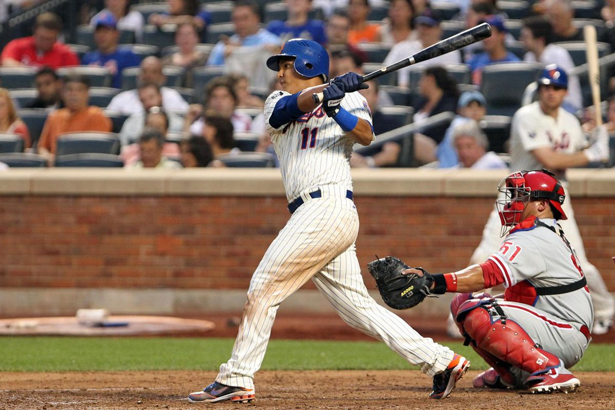 July 3, 2012; Flushing, NY,USA;   New York Mets shortstop Ruben Tejada (11) hits a RBI single during the fourth inning against the Philadelphia Phillies at Citi Field.  Mandatory Credit: Anthony Gruppuso-US PRESSWIRE