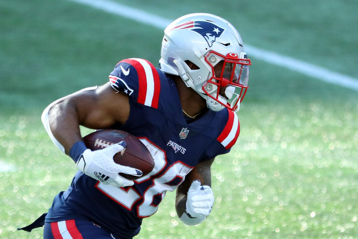 James White #28 of the New England Patriots carries the ball against the Denver Broncos during the second half at Gillette Stadium on October 18, 2020 in Foxborough, Massachusetts.
