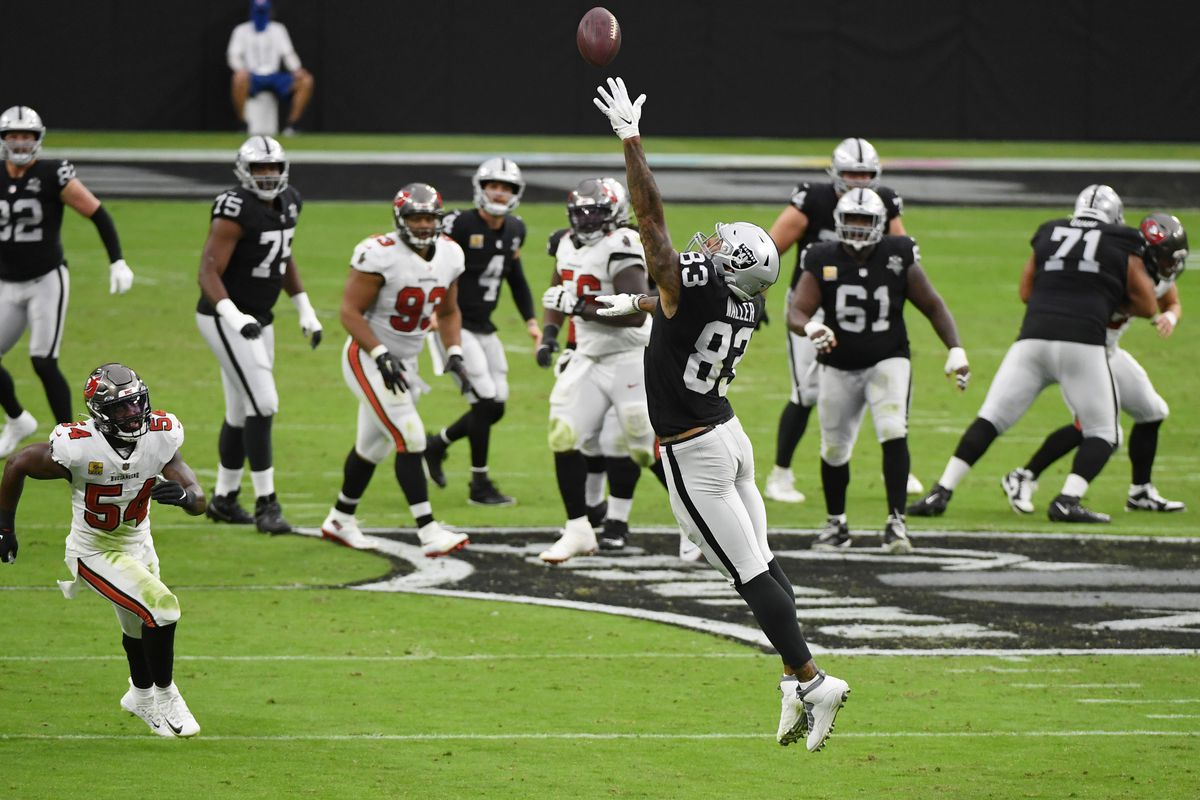 Tight end Darren Waller #83 of the Las Vegas Raiders can't reach a pass from quarterback Derek Carr during the first half of their game against the Tampa Bay Buccaneers at Allegiant Stadium on October 25, 2020 in Las Vegas, Nevada.