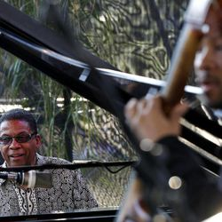 Herbie Hancock,  left, and bassist Roland Guerin perform at a sunrise concert marking International Jazz Day in New Orleans, Monday, April 30, 2012. The performance, at Congo Square near the French Quarter, is one of two in the United States Monday; the other is in the evening in New York. Thousands of people across the globe are expected to participate in International Jazz Day, including events in Belgium, France, Brazil, Algeria and Russia.