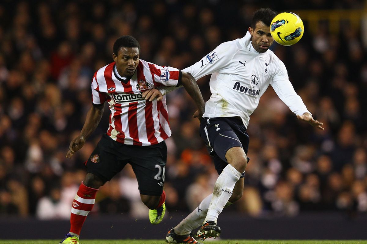 Sandro of Spurs and Stephane Sessegnon of Sunderland battle for the ball during the Barclays Premier Leauge match between Tottenham Hotspur and Sunderland at White Hart Lane in London, England. (Photo by Julian Finney/Getty Images)