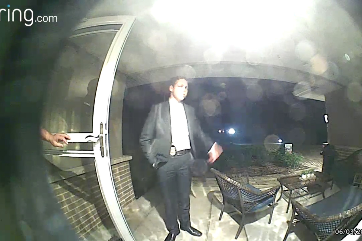 """Screen grab of a """"Ring"""" doorbell camera feed, showing a man police said impersonated a Winfield police officer."""