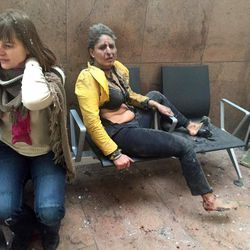 In this photo provided by Georgian Public Broadcaster and photographed by Ketevan Kardava two women wounded in Brussels Airport in Brussels, Belgium, after explosions were heard Tuesday, March 22, 2016. A developing situation left at least 34 people dead in explosions that ripped through the departure hall at Brussels airport Tuesday, police said. All flights were canceled, arriving planes were being diverted and Belgium's terror alert level was raised to maximum, officials said.