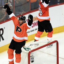 Philadelphia Flyers Jaromir Jagr, left, and Scott Hartnell circle behind the goal arms raised as they celebrate Claude Giroux's goal in the opening minute of the third period of Game 3 in a first-round NHL Stanley Cup playoffs hockey series with the Pittsburgh Penguins  Sunday, April 15, 2012, in Philadelphia. The Flyers' 8-4 win puts them ahead 3-0 in the series. (AP Photo/Tom Mihalek)