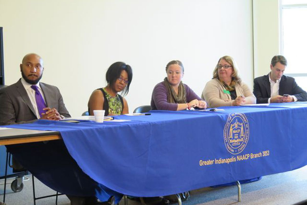 Five of the 10 candidates seeking election to the Indianapolis Public School Board sit at a candidate forum hosted by the Greater Indianapolis NAACP chapter.