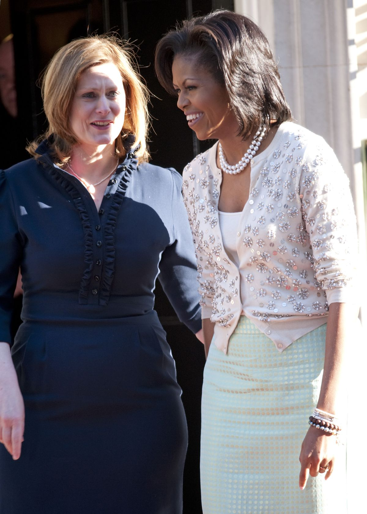 Michelle Obama at 10 Downing Street in London wearing a cardigan and skirt by J.Crew in May 2009.