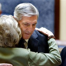Recently retired Jazz coach Jerry Sloan is hugged by Anna Kay Waddoups in the Senate at the Utah state Capitol.