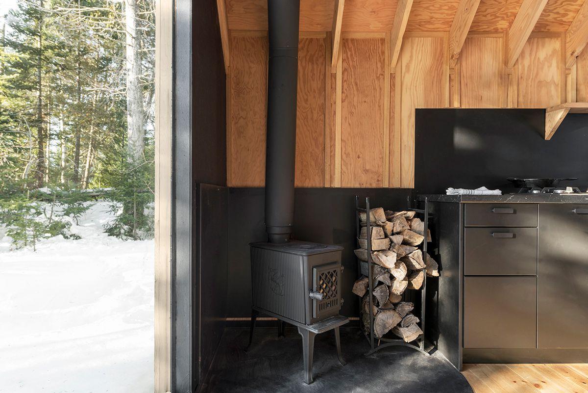 Wood burning stove in corner