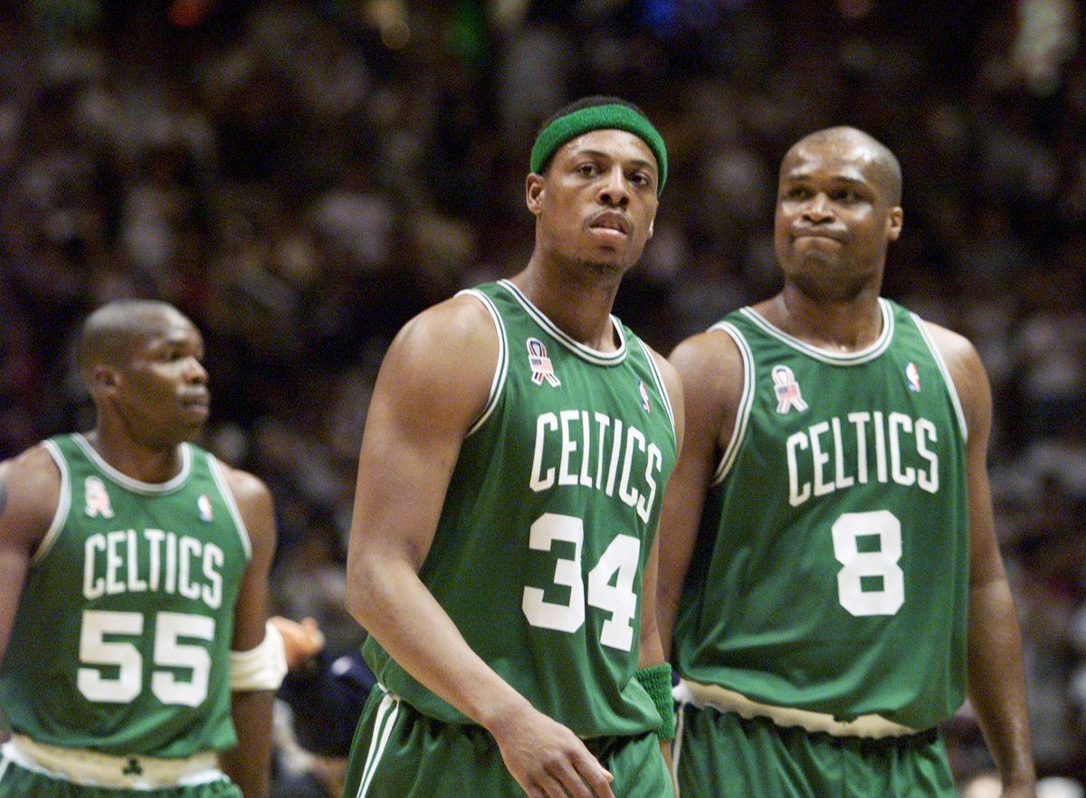 Boston Celtics' Paul Pierce (34) leads teammates Antoine Wal