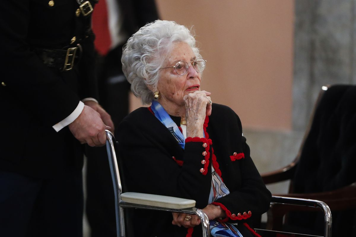 Annie Glenn arrives to view the casket of her husband, famed astronaut and U.S. Sen. John Glenn, as he lies in honor, in Columbus, Ohio, in 2016. Glenn died Tuesday of COVID-19 complications at age 100.