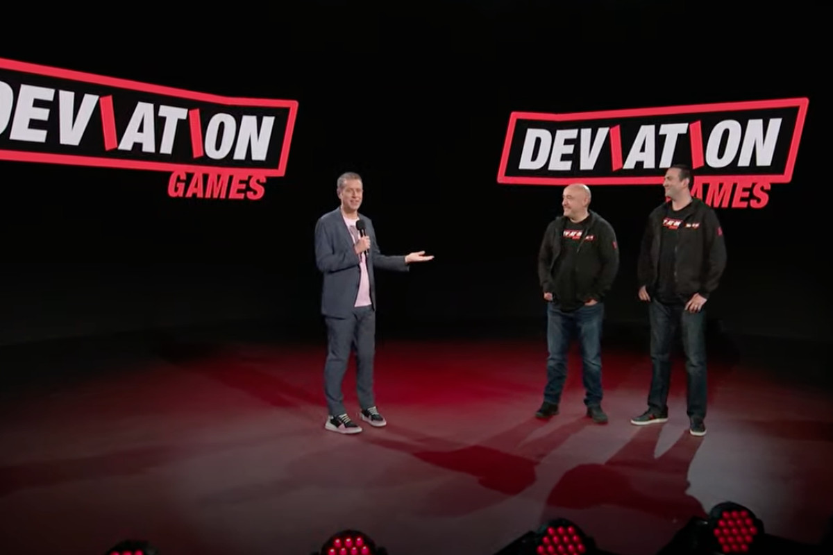 Three people stand on stage during the Summer Game Fest Kickoff Live show