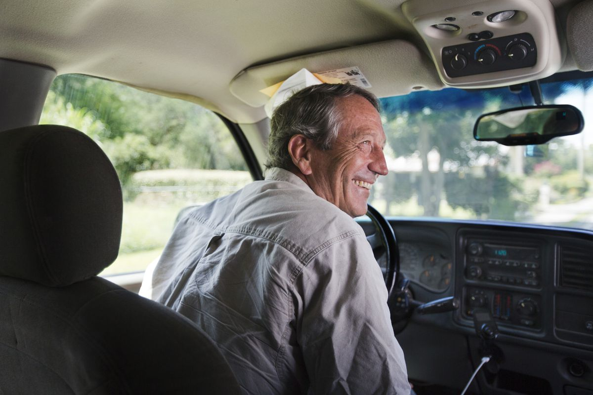 Former governor and congressman Mark Sanford stops beside a fruit stand to speak with his brother, John, before going to lunch at Lowcountry Produce on Saturday, August 24, 2019, in Beaufort, SC.