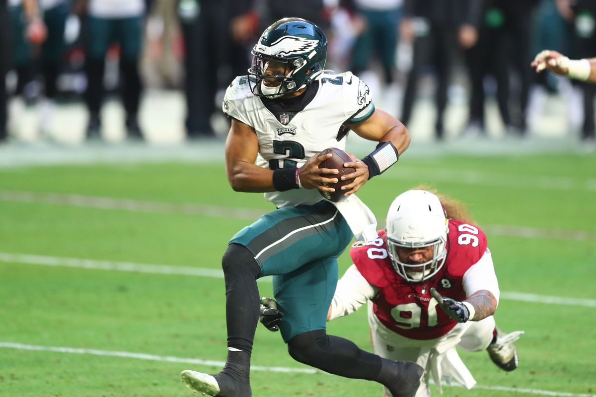Philadelphia Eagles quarterback Jalen Hurts (2) runs the ball in for a touchdown against the Arizona Cardinals during the second half at State Farm Stadium.