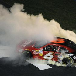 Ricky Stenhouse Jr. celebrates his win with a burnout after the NASCAR Nationwide Series auto race at Atlanta Motor Speedway, Saturday, Sept. 1, 2012 in Hampton, Ga.